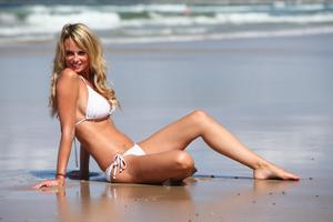 Rhian-sugden-shows-off-her-curvy-body-in-a-tiny-white-bikini-at-belongil-beach-i-o4lt9bruk5.jpg